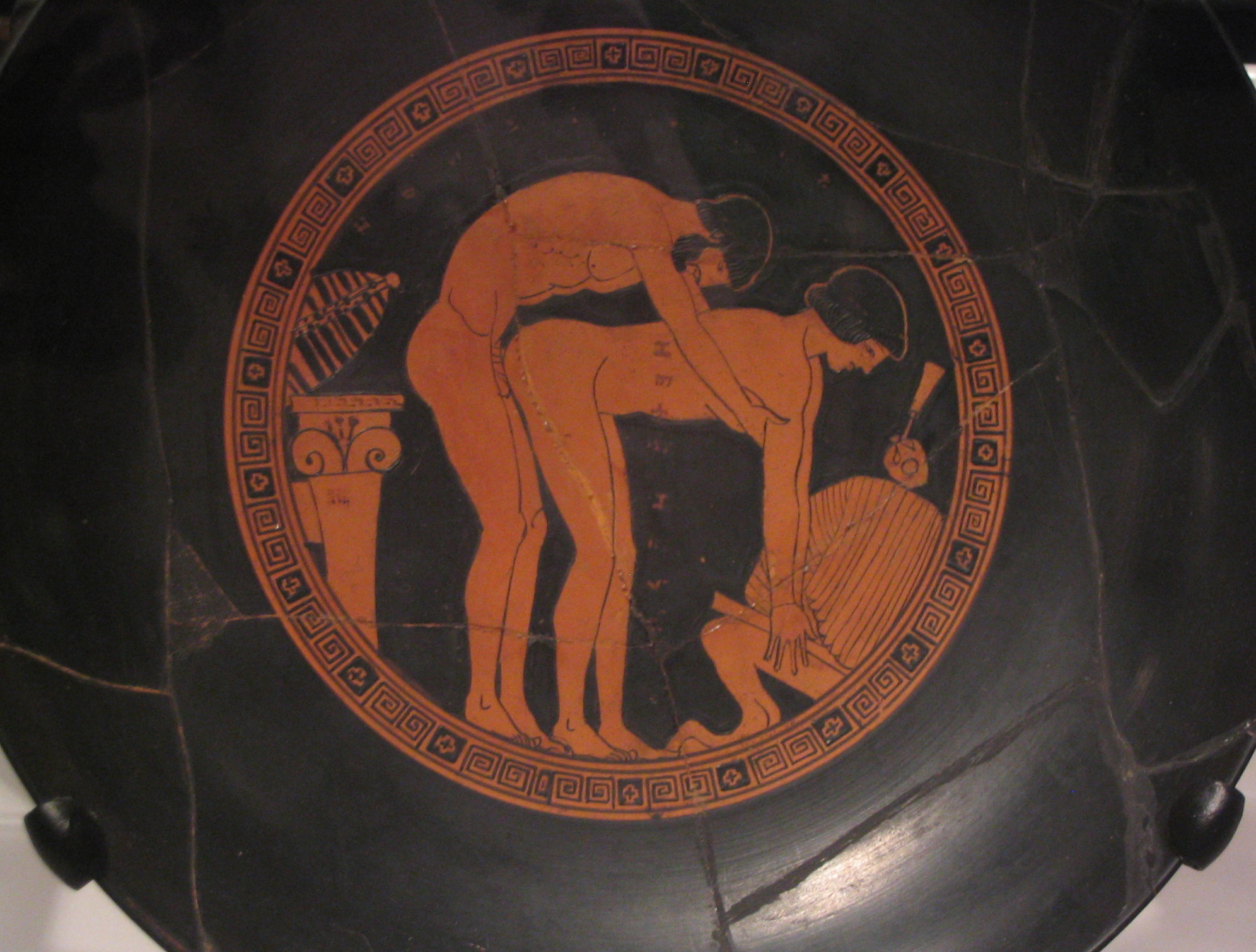 Ancient greek plate with erotic scene